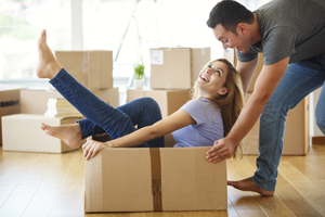 Couple and moving box